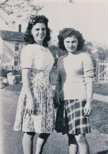 My mom and her sister my Aunt Marie in the fitted sweater
